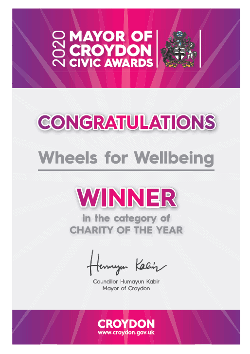 Certificate declaring us winner of the Charity of the year. it is purple and silver with the Mayor of Croydon's crest on the top right